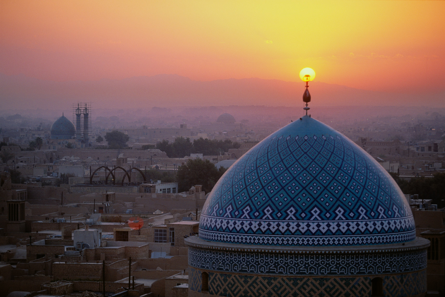 Image of The Sun setting on mosque
